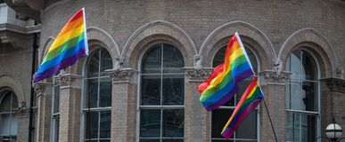 Close up of rainbow LGBT flags flying at the Gay Pride Parade in London 2018. Photographed outside The Langham Hotel. Regent Street, London UK. Close up of royalty free stock images