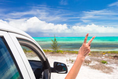 Close up raised hands at perfect beach royalty free stock photo