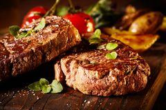 Close up of rare roasted juicy medallion of fillet. Close up of a rare roasted juicy medallion of beef fillet seasoned with salt and spices and garnished with royalty free stock photo