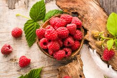 Close up of raspberry in a bowl on a shabby  wood. Top view Royalty Free Stock Photo