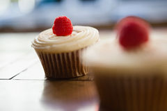 Close up of raspberry cupcakes on table Royalty Free Stock Images