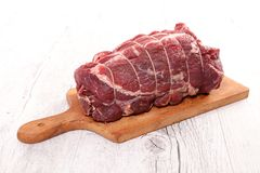 Raw beef on board. Close up on raw beef on board Royalty Free Stock Photo