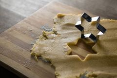 Raw cookie dough with star shape and cutter Stock Photography