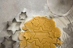 Raw cookie dough with star shape and cutter Stock Photos