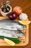 Close-up raw fish trout on a wooden board Royalty Free Stock Images