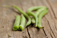 Close-up of raw green beans. On old wooden table Stock Photo