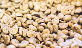 Close up raw green coffee beans unroasted background and texture Royalty Free Stock Image