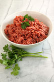 Close up of raw ground beef on cutting board Royalty Free Stock Images