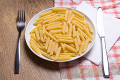 Close up of raw italian pasta in plate Stock Image