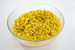 Raw macaroni in a glass bowl Stock Photo