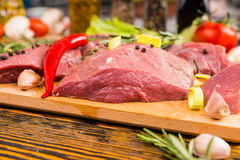 Close up of raw meat with peppers Stock Photo