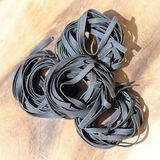 Close up of raw pasta, Black Squid ink fettuccine Stock Photography