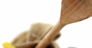 Close-up of raw pasta with wooden spoon. In a sack stock video footage