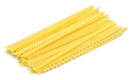Close-up of raw yellow pasta isolated on white. Yellow raw pasta color white background view Stock Images