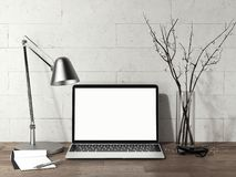 Laptop with blank screen on wooden table next to metal lamp, 3d rendering. Close up of realistic black laptop with blank screen on wooden table next to metal royalty free stock image