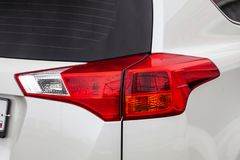 Close-up on the rear brake light of red color on a white car in the back of a suv after cleaning, polishing and detailing in the royalty free stock images