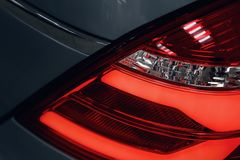 Close-up of the rear light of a modern car. Led optics of the car royalty free stock images