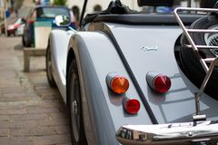 Close up of the rear lights of a classic car parked in the street stock images