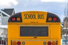 Close up of the rear of a school bus with a window and several signal lights royalty free stock image