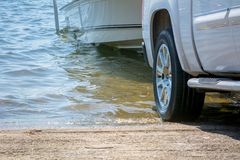 Close Up of the Rear of a Truck Recovering a Boat from the Sea. On Blur Background royalty free stock images