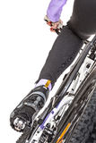 Close up rear view cyclist pedaling bike Stock Photo