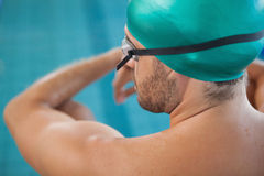 Close up rear view of a fit swimmer by the pool Royalty Free Stock Photos