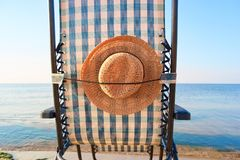 Close up rear view sun hat attached to deck chair. stock image