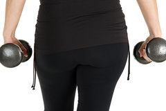 Close up rear view of a woman model working with weights Stock Photo