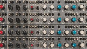 Close up of a recording studio`s mixer royalty free stock photography