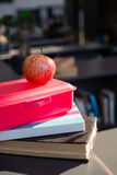 Close up of red apple on tiffin box at library Royalty Free Stock Image