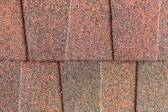 Close up red asphalt shingle background. Red asphalt shingle for roof work Stock Photo