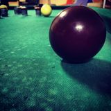 Close up of a red ball at a billards game Royalty Free Stock Images