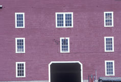 Close up of red barn with windows, VT Royalty Free Stock Photos