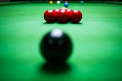 Close up of red and black balls on Snooker table royalty free stock images