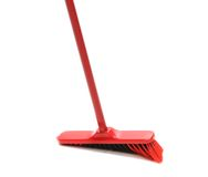 Close up of red black broom. Stock Photos