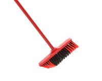 Close up of red black broom. Royalty Free Stock Photo