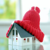 Close up Red bobble hat on Cute Little House Royalty Free Stock Images