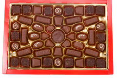Close-up red box of chocolates. Isolated on white Royalty Free Stock Images