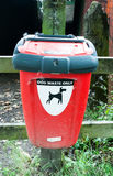 Close up red box for disposal of dog waste Royalty Free Stock Photo