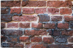 Close-up of red brick Tudor architeture exterior wall. Detail close-up of dilapidated exterior Tudor architecture wall Stock Photography