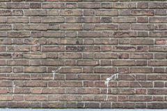 Close-up red brick wall with some white paint splatter. On the surface of the wall. Great to use as a background, backdrop or desktop royalty free stock photography