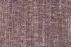 Close up of red/brown colored fine textured cotton Royalty Free Stock Image