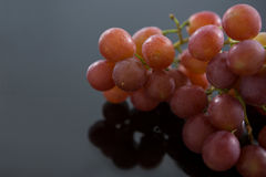 Close-up of red bunch of grapes. On grey background royalty free stock images