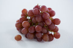 Close-up of red bunch of grapes. On white background stock photos