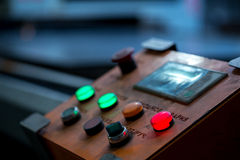 Close-up of red button lit on control panel. Image of red button lit on control panel, close-up Stock Photography