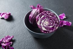 Close-up of red cabbage in bowl. On slate Royalty Free Stock Photography