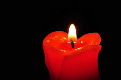 Close up of a Red candle light. Isolated candle's light with black background royalty free stock photo