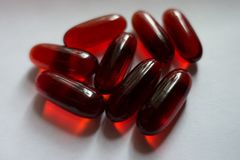 Closeup of red capsules of krill oil. Close up of red capsules of krill oil Stock Photo
