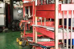 Automobile repair tools, car tools. Close-up with red car toolbox and various repair tools Royalty Free Stock Photography