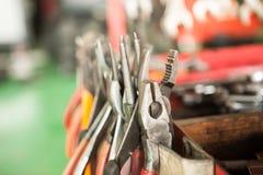 Various repair tools. Close-up with red car toolbox and various repair tools Royalty Free Stock Images